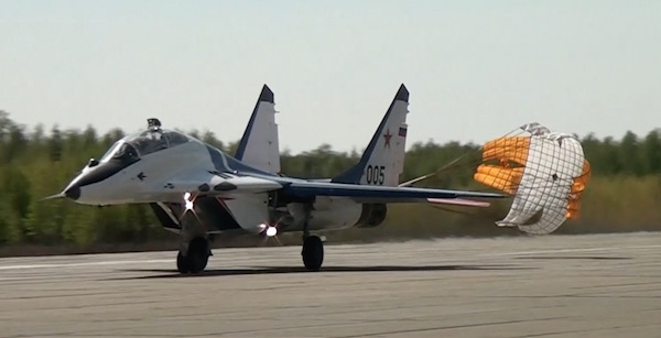 Mig29 on landing with parachute.
